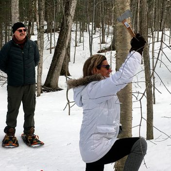 People Throwing Axes in the Winter